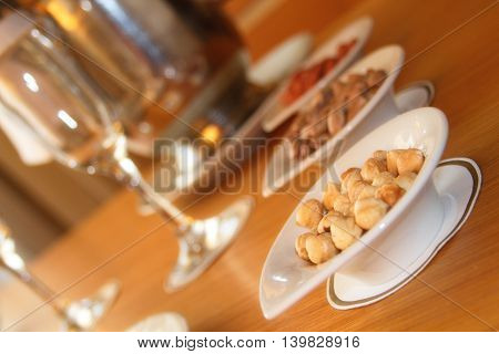 Tableware glasses champagne and a lot of different nuts