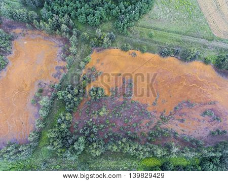 Old Sulfuric Acid Natural Tank Orange Color In South Of Poland.