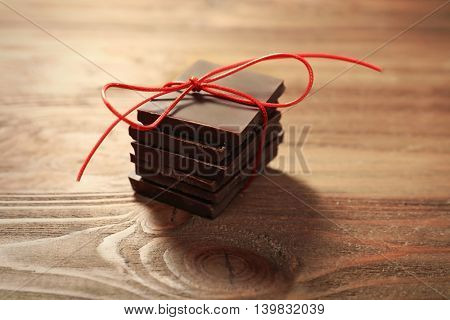 Pile of chocolate slices on wooden background