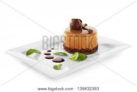 Caramel cake on light background