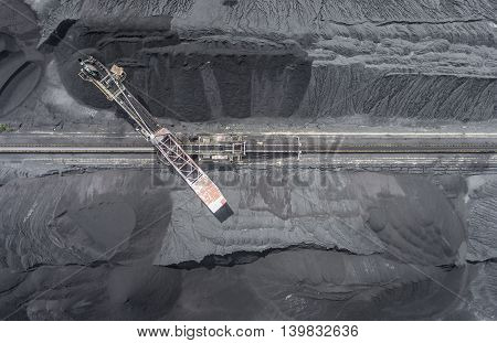 Mining Excavator On The Bottom Surface Mine. Brown Coal Deposits. View From Above.