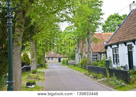 View of typical historic street in Ameland The Netherlands