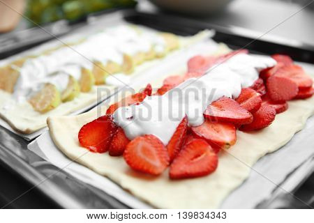 Strawberry and apple desserts in oven tray