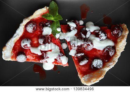 Cherry pie slices on black background