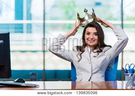 Businesswoman sitting at the office desk