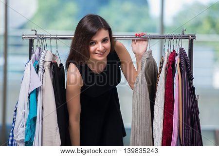 Woman choosing clothing in shop