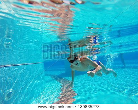 boy swimming in the pool