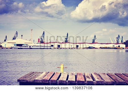 Vintage Toned Old Pier With Harbor In Distance