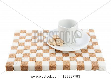 empty coffee cup on a saucer with three brown sugar pieces on a stand of white and brown sugar. Isolated on white.