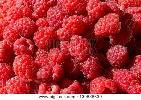 Fresh Raspberry as a background closeup photo