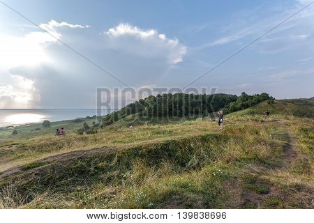 Pereslavl Zalessky, Russia - July 23, 2016: Evening summer view from Alexandrova of the mountain on Pleshcheevo lake with clouds and a rain on other coast.