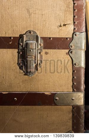 Traditional Clasp and Latch Luggage Lock on Worn and Used Travel Trunk Chest