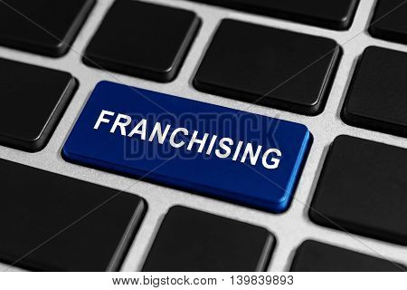 franchising blue button on keyboard business concept