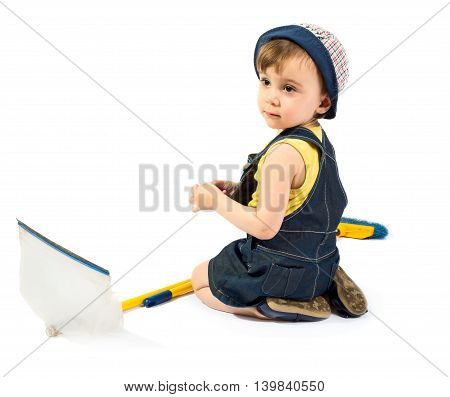 Cute baby girl with broom and dustpan isolated on white background