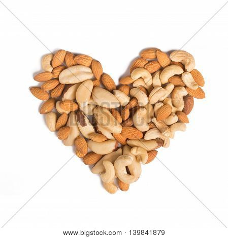 Almond cashew and Para nuts heart shaped in white background