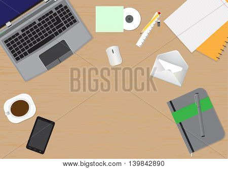 Top view of desk background with laptop, mouse, digital devices, office objects with notepad