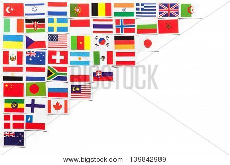 National flags of the different countries of the world located on the left side diagonally. On the right side a copy space