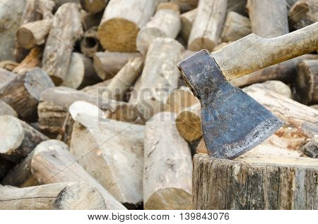 The axe to prick wood on a wooden background