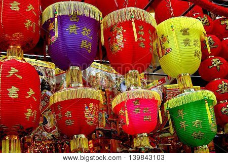 Hong Kong China - December 15 2005: Colourful Chinese paper lanterns hang from a store on Queen's Road in the Sheung Wan district