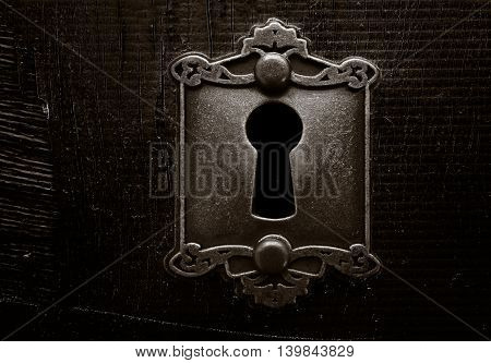 Old lock on a weathered wooden door
