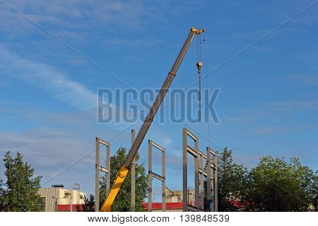 Construction site wirh crane and metal profile structure photo