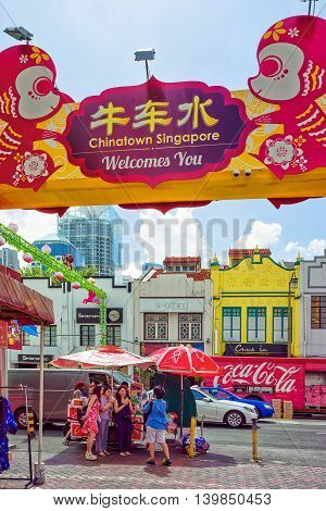 Singapore Chinatown Street Market Decorated With Paper Lanterns And Tourists