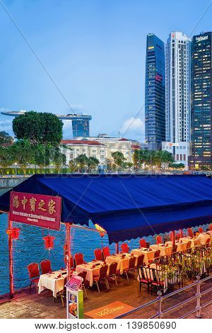 Street Restaurant And  Skyscrapers Of Financial Center In Singapore