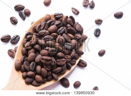 Coffee beans with spoon isolated on white background