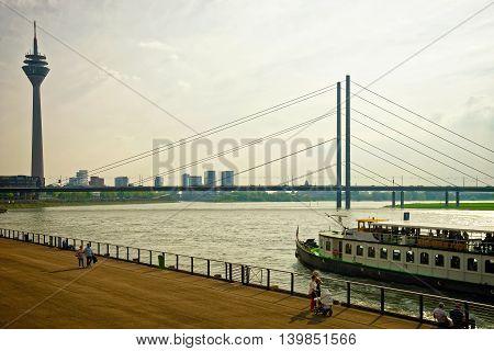 Rheinturm Tower And Rhine Embankment Promenade In Dusseldorf
