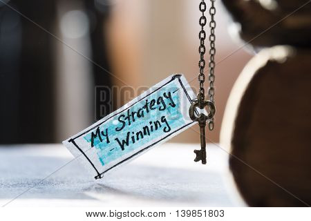 winning strategy concept - label and golden key