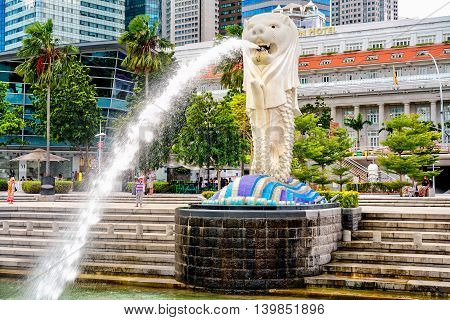 Skyscrapers And Merlion Statue At Merlion Park Of Singapore