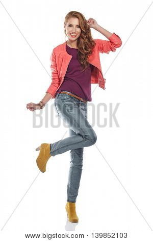Amazing beautiful brunette woman in autumn color. Studio shoot