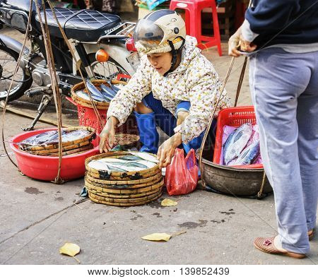 Asian Buyer And Trader Selling Fresh Fish In Street Market