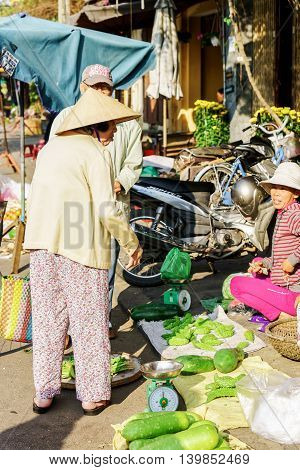 Asian Customers And Trader Selling Fresh Bitter Melon And Zucchini