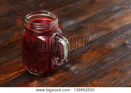 Glass Of Fresh Berry Smoothie, Cocktail On Wooden Background