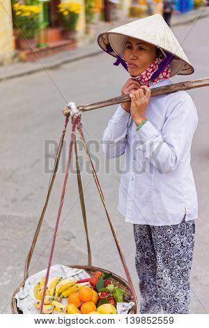 Asian Trader Carrying Rambutan Mango Banana And Mandarin