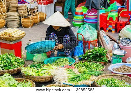 Asian Trader In A Traditional Hat Selling Fresh Salading