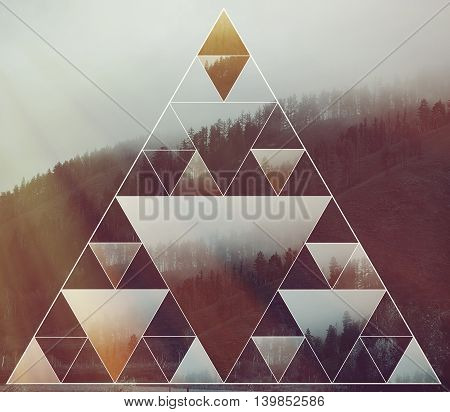 Abstract background with the image of the forest mountains and the sacred geometry symbol triangle. Harmony spirituality unity of nature. Collage mosaic.