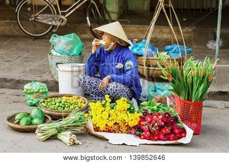 Asian Trader Selling Fresh Flowers Fruit And Vegetables