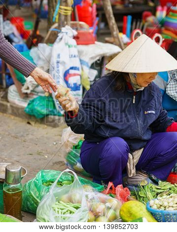 Asian Trader Selling Fresh Vegetables In The Street Open Market