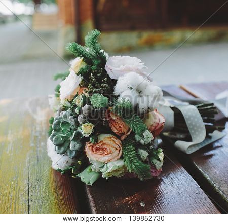 Wedding bouquet on a bench, close view