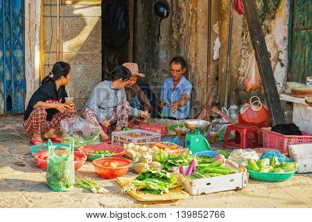 Asian Traders Selling Fresh Fruit And Vegetables In Street Market