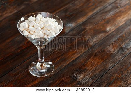 Glass With White Fluffy Marshmallows On Wooden Background, Copy Space