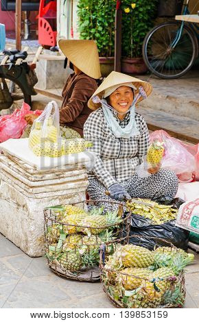 Asian Woman Selling Cleaned Ananas In Vietnam