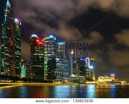 Singapore Skyline Of Downtown Core In Marina Bay At Twilight