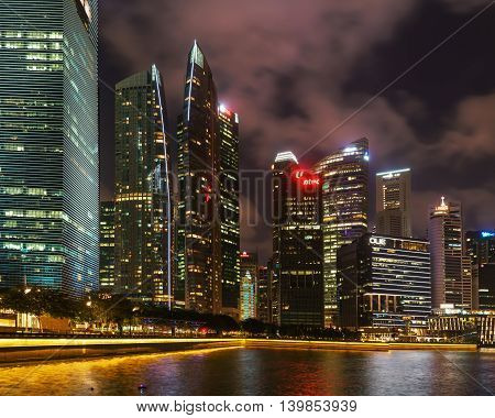 Singapore Skyline Of Downtown Core In Marina Bay At Night
