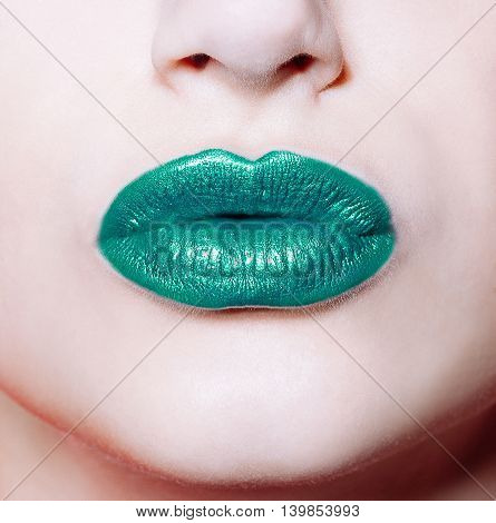 Woman  Lips With Glossy Green Lipstick