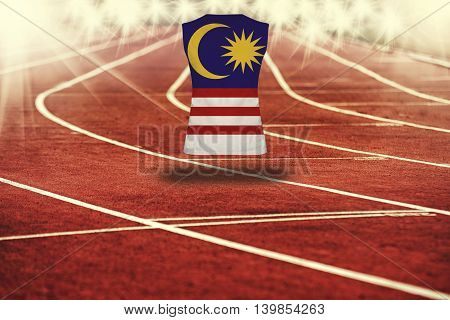 Red Running Track With Lines And Malysia Flag On Shirt