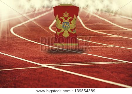 Red Running Track With Lines And Montenegro Flag On Shirt