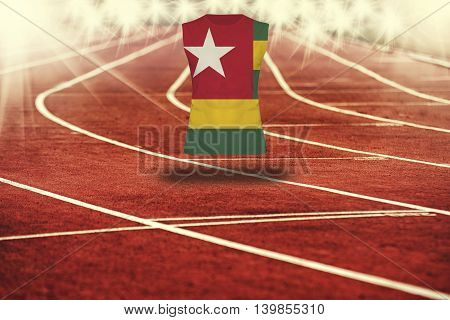 Red Running Track With Lines And Togo Flag On Shirt